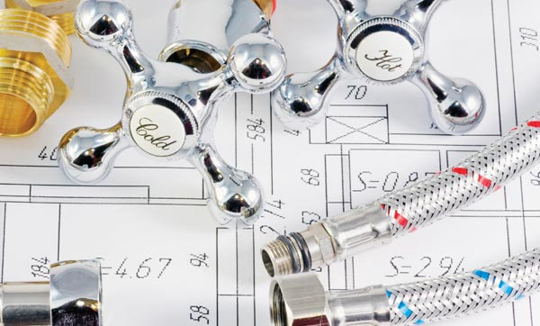 Plumbing Components on top of a Technical Drawing